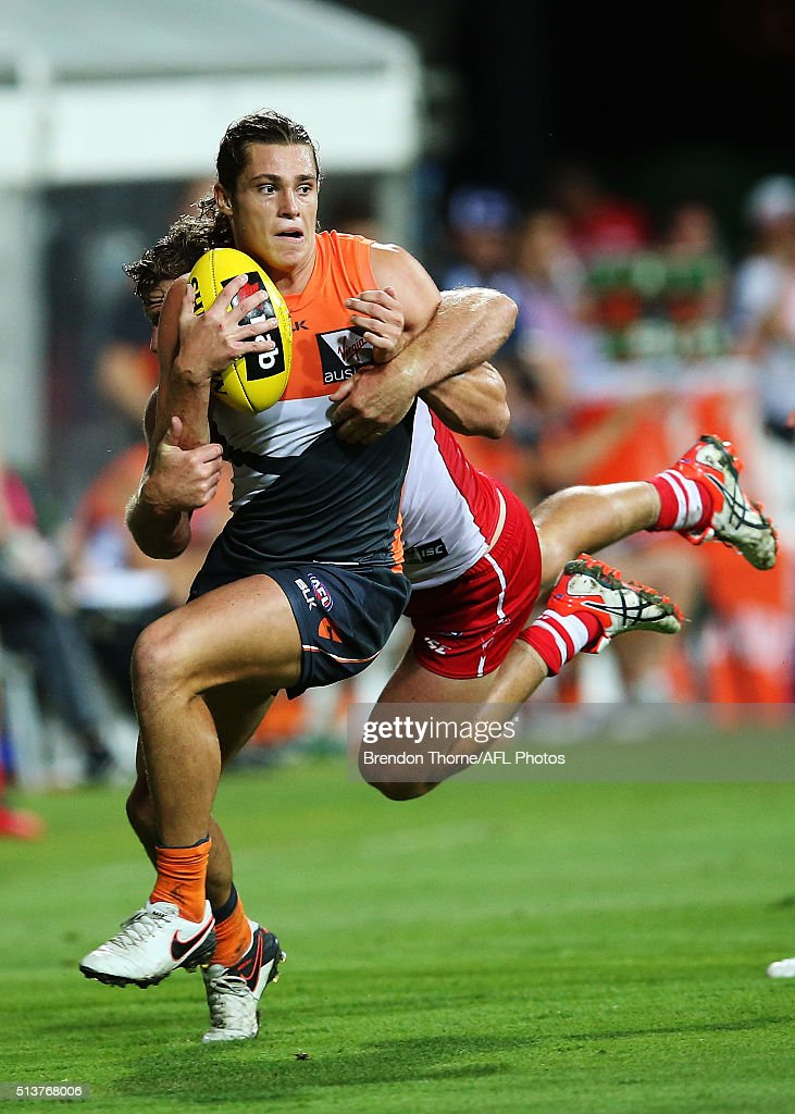 Jack Steele of the Giants competes with Luke Parker of the Swans during the 2016 AFL NAB Challenge match between the Sydney Swans and the Greater Western Sydney Giants at Drummoyne Oval on March 4, 2016 in Sydney, Australia.