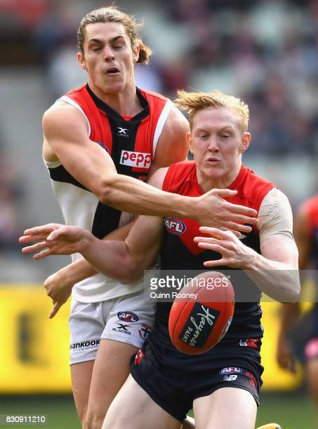 Jack Steele of the Saints and Clayton Oliver of the Demons compete for the ball during the round 21 AFL match between the Melbourne Demons and the St...