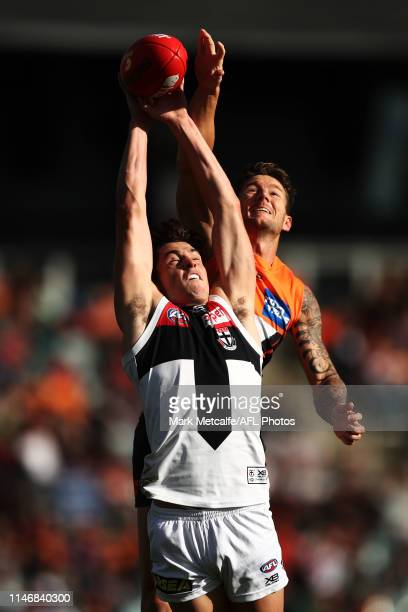Jack Steele of the Saints competes for the ball against Daniel Lloyd of the Giants during the round seven AFL match between the Greater Western...