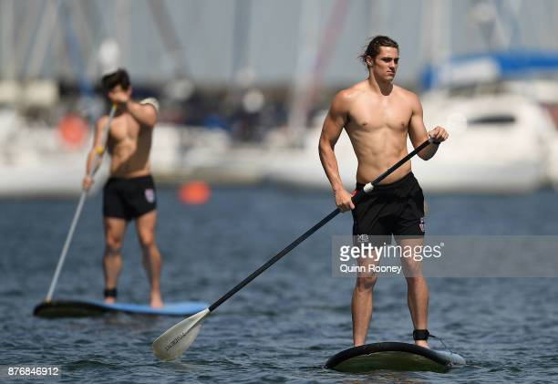 Jack Steele of the Saints does stand up paddleboarding during a St Kilda Saints AFL training session at Catani Gardens on November 21 2017 in...