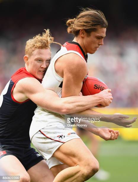 Jack Steele of the Saints is tackled by Clayton Oliver of the Demons during the round 21 AFL match between the Melbourne Demons and the St Kilda...