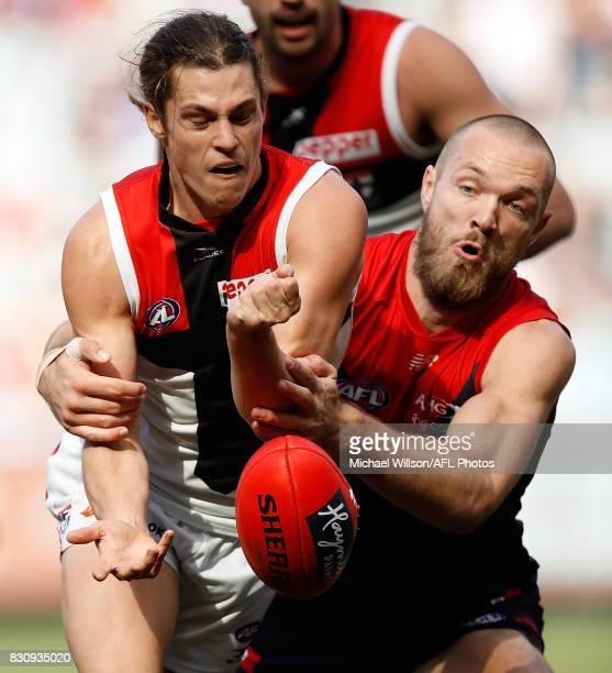 Jack Steele of the Saints is tackled by Max Gawn of the Demons during the 2017 AFL round 21 match between the Melbourne Demons and the St Kilda...