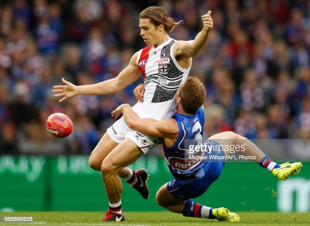 Jack Steele of the Saints is tackled by Mitch Wallis of the Bulldogs during the 2017 AFL round 10 match between the Western Bulldogs and the St Kilda...