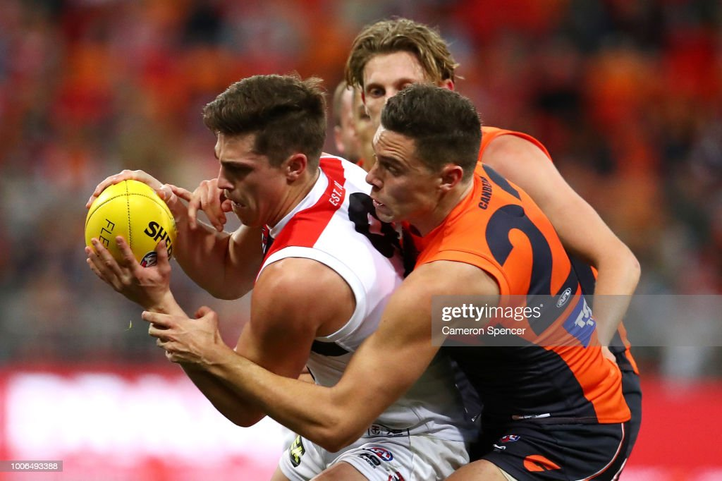 Jack Steele of the Saints is tackled during the round 19 AFL match between the Greater Western Sydney Giants and the St Kilda Saints at Spotless Stadium on July 28, 2018 in Sydney, Australia.