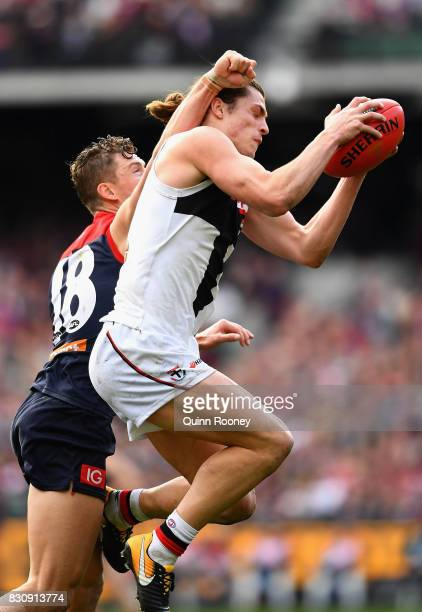 Jack Steele of the Saints marks infront of Jake Melksham of the Demons during the round 21 AFL match between the Melbourne Demons and the St Kilda...
