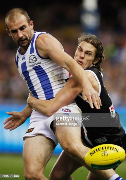 Jack Steele of the Saints tackles Ben Cunnington of the Kangaroos during the round 22 AFL match between the St Kilda Saints and the North Melbourne...