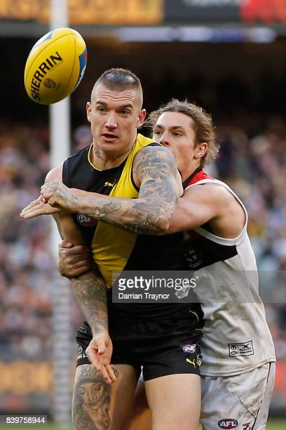 Jack Steele of the Saints tackles Dustin Martin of the Tigers during the round 23 AFL match between the Richmond Tigers and the St Kilda Saints at...