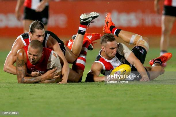 Jack Steele of the Saints tackles Lance Franklin of the Swans during the JLT Community Series AFL match between the St Kilda Saints and the Sydney...