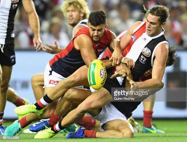 Jack Steele of the Saintsis tackled by Christian Salem and Jeff Garlett of the Demons during the round one AFL match between the St Kilda Saints and...