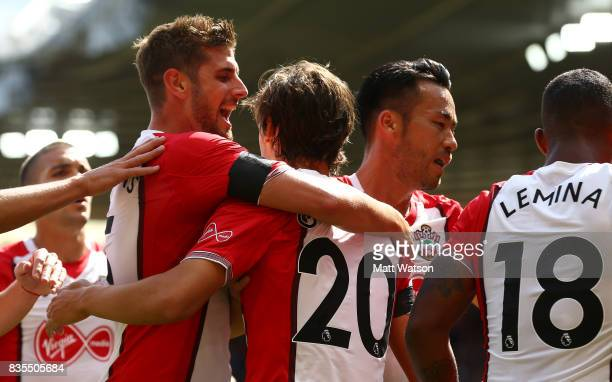 Jack Stephens joins the celebrations after Manolo Gabbiadini scores during the Premier League match between Southampton and West Ham United at St...