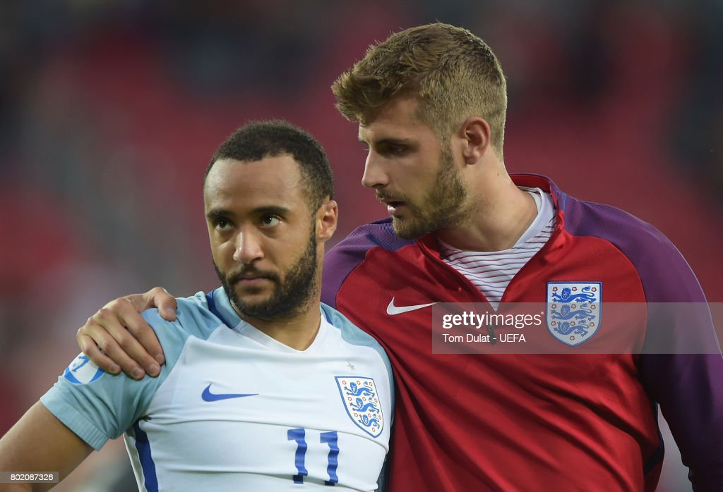 Jack Stephens of England consoles Nathan Redmond of England after he missed England's fifth penatly and sent them out of the tournament during the UEFA European Under-21 Championship Semi Final match between England and Germany at Tychy Stadium on June 27, 2017 in Tychy, Poland.