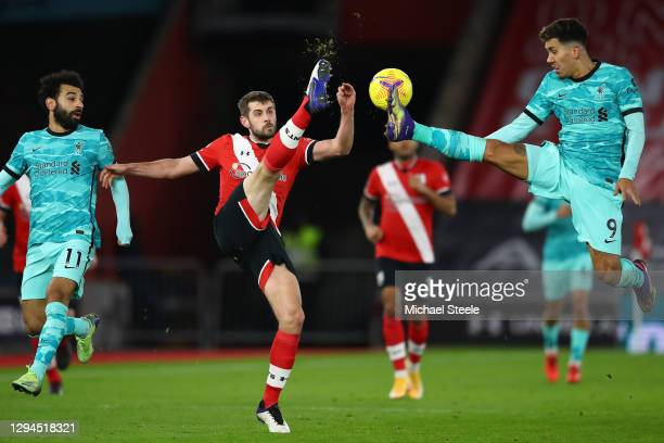 Jack Stephens of Southampton battles for possession with Roberto Firmino of Liverpool during the Premier League match between Southampton and...
