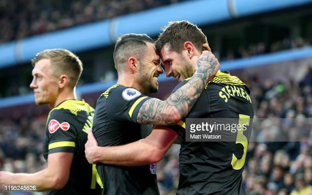 Jack Stephens of Southampton celebrates with Danny Ings after scoring his team's second goal during the Premier League match between Aston Villa and...