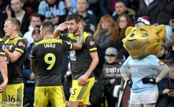 Jack Stephens of Southampton celebrates with teammates after scoring his team's second goal during the Premier League match between Aston Villa and...