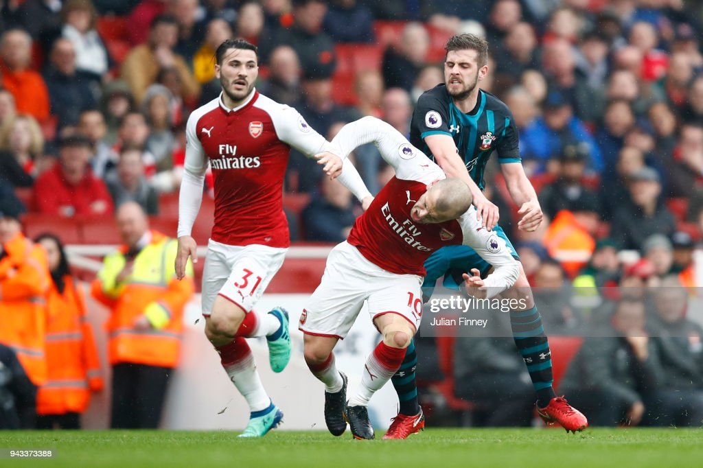 Jack Stephens of Southampton clashes with Jack Wilshere of Arsenal which later leads to Jack Stephens of Southampton being shown a red card during the Premier League match between Arsenal and Southampton at Emirates Stadium on April 8, 2018 in London, England.