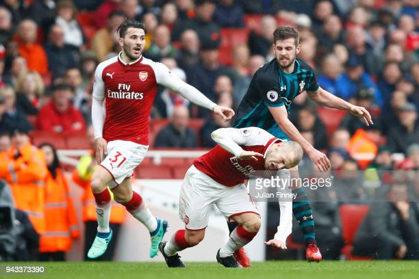 Jack Stephens of Southampton clashes with Jack Wilshere of Arsenal which later leads to Jack Stephens of Southampton being shown a red card during...
