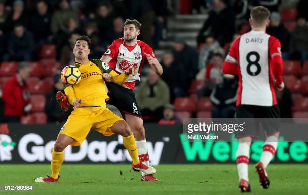 Jack Stephens of Southampton FC and Leonardo Ulloa of Brighton during the Premier League match between Southampton and Brighton and Hove Albion at St...