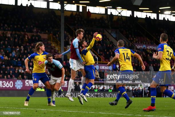 Jack Stephens of Southampton handles the ball in the area to give Burnley a Penalty during the Premier League match between Burnley FC and...
