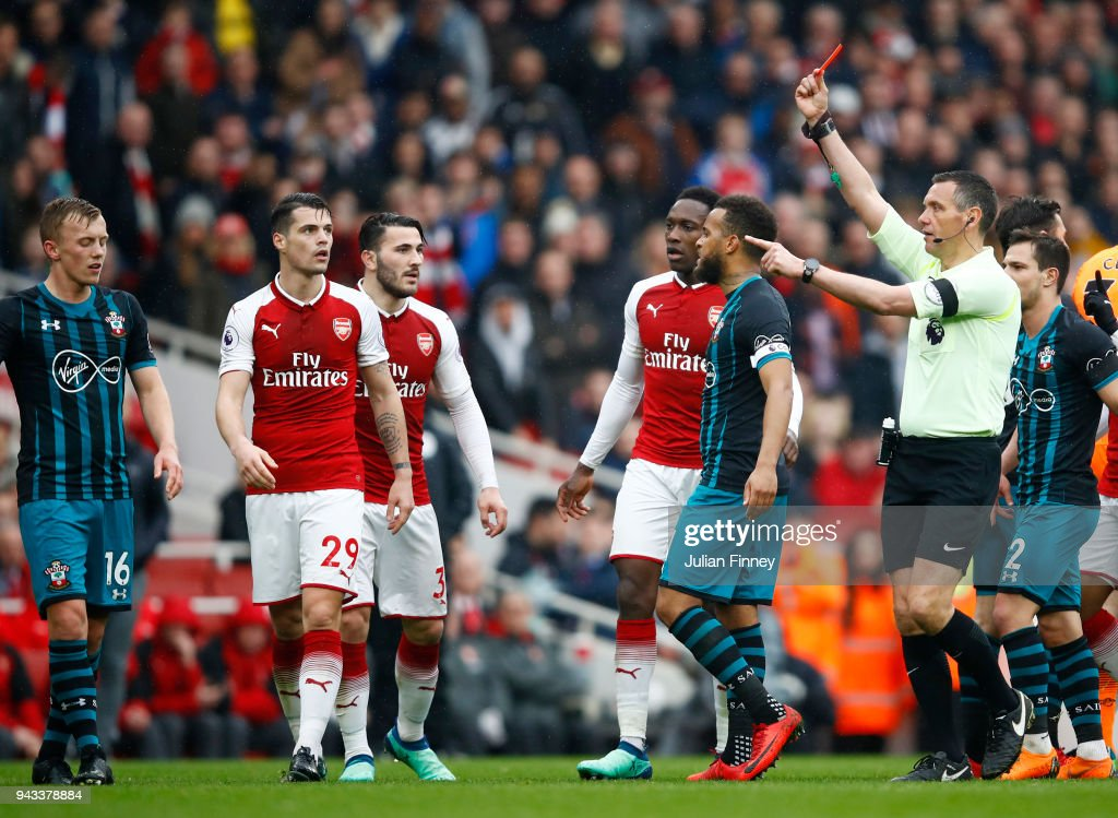 Jack Stephens of Southampton (not pictured) is shown a red card by referee Andre Marriner during the Premier League match between Arsenal and Southampton at Emirates Stadium on April 8, 2018 in London, England.