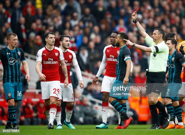 Jack Stephens of Southampton is shown a red card by referee Andre Marriner during the Premier League match between Arsenal and Southampton at...