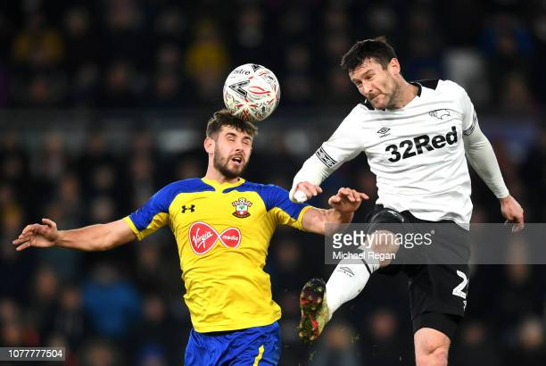 Jack Stephens of Southampton wins a header over David Nugent of Derby County during the FA Cup Third Round match between Derby County and Southampton...