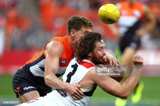 Jack Steven of the Saints handpasses during the round 19 AFL match between the Greater Western Sydney Giants and the St Kilda Saints at Spotless...