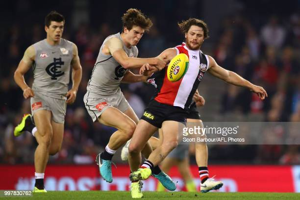 Jack Steven of the Saints is tackled by Paddy Dow of the Blues during the round 17 AFL match between the St Kilda Saints and the Carlton Blues at...