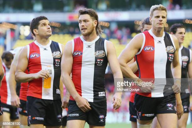 Jack Steven of the Saints Leigh Montagna and Nick Riewoldt looks dejected after defeat during the round nine AFL match between the St Kilda Saints...