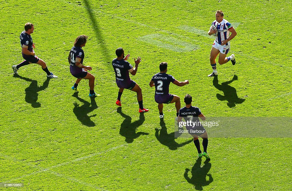 Jack Stockwell of the Knights runs with the ball towards the Storm defence during the round five NRL match between the Melbourne Storm and the Newcastle Knights at AAMI Park on April 2, 2016 in Melbourne, Australia.