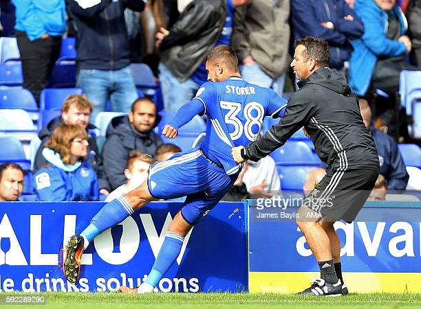 Jack Storer of Birmingham City reacts by kicking a sponsorship board after being sent off during the Sky Bet Championship match between Birmingham...