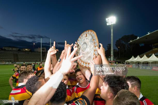 Jack Stratton of Waikato and his team mates lift the Ranfurly Shield after their win in the round four Mitre 10 Cup Ranfurly Shield match between...