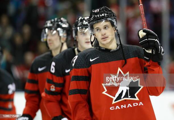 Jack Studnicka of Team Canada raises his stick to salute the fans following a game versus Team Slovakia at the IIHF World Junior Championships at the...