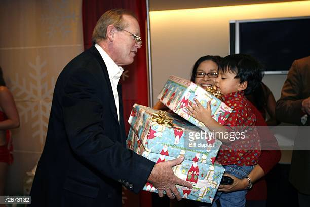 Jack Sweeney Publisher of the Houston Chronicle gives gifts during the sixth annual Good Fellows hosted by Leslie Alexander on December 23 2006 at...