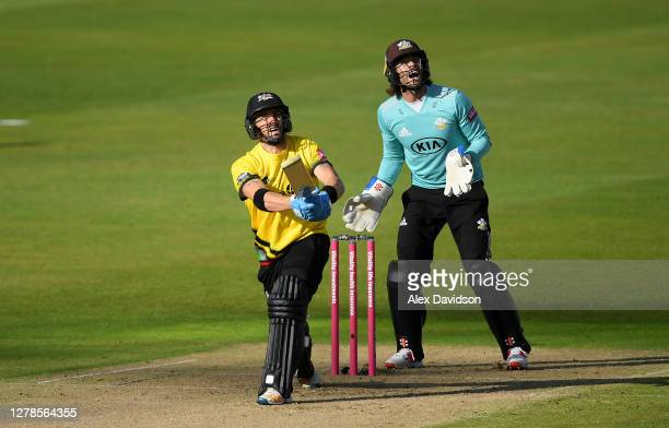 Jack Taylor of Gloucestershire hits out watched on by Ben Foakes of Surrey during the Vitality Blast 2020 Semi Final match between Surrey and...
