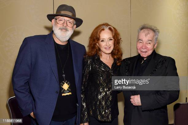 Jack Tempchin Bonnie Raitt and John Prine pose backstage during the Songwriters Hall Of Fame 50th Annual Induction And Awards Dinner at The New York...