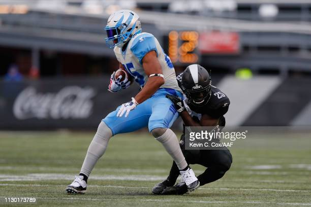 Jack Tocho of the Birmingham Iron brings down Nick Truesdell of Salt Lake Stallions during an Alliance of American Football game at Legion Field on...
