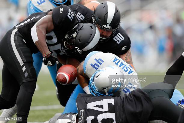 Jack Tocho of the Birmingham Iron forces a fumble by MattAsiata of Salt Lake Stallions during an Alliance of American Football game at Legion Field...