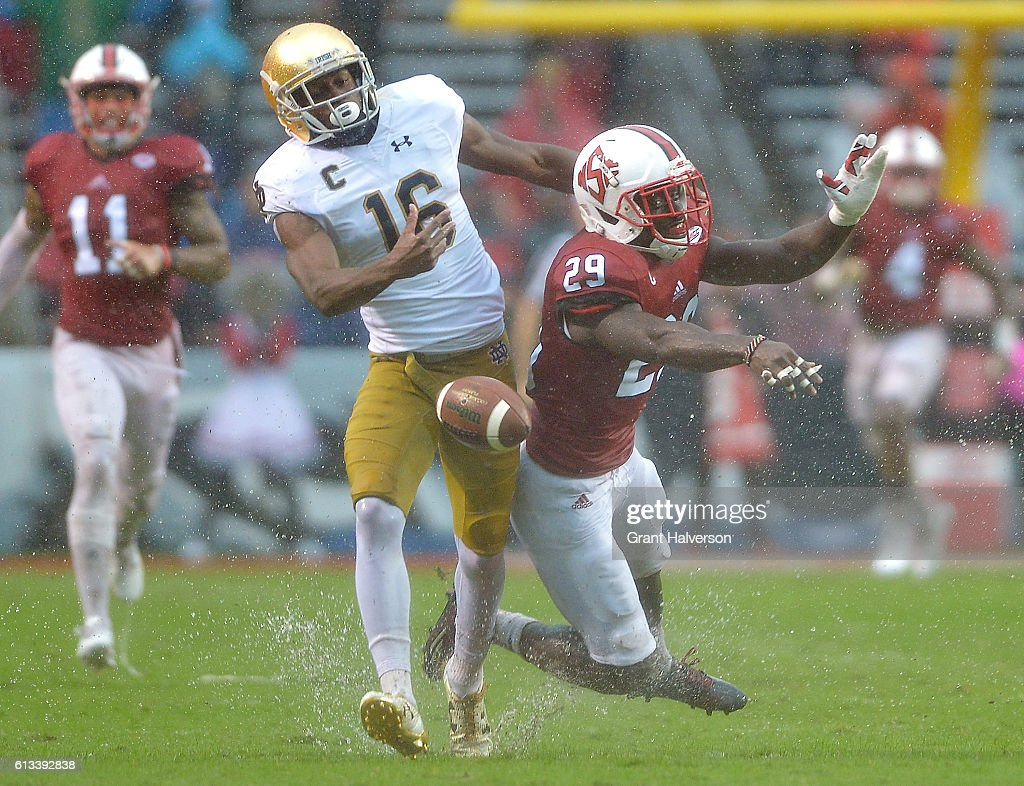 Jack Tocho #29 of the North Carolina State Wolfpack breaks up a pass intended for Torii Hunter Jr. #16 of the Notre Dame Fighting Irish during the game at Carter Finley Stadium on October 8, 2016 in Raleigh, North Carolina. North Carolina State won 10-3.