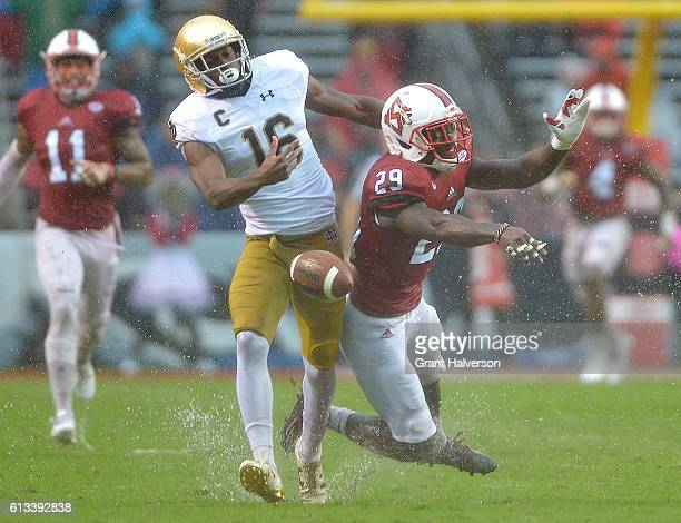 Jack Tocho of the North Carolina State Wolfpack breaks up a pass intended for Torii Hunter Jr #16 of the Notre Dame Fighting Irish during the game at...