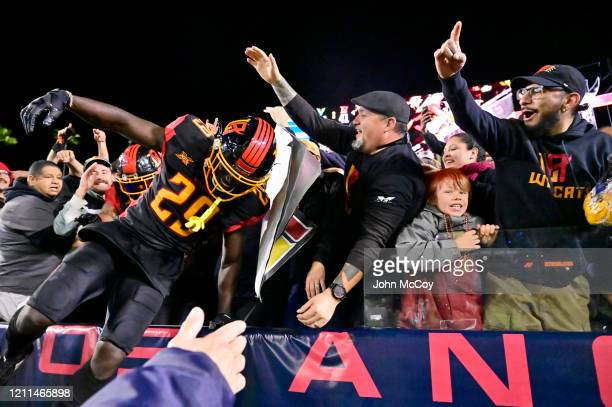 Jack Tocho of the LA Wildcats jumps out of the stands after celebrating with fans after a score against the Tampa Bay Vipers at Dignity Health Sports...