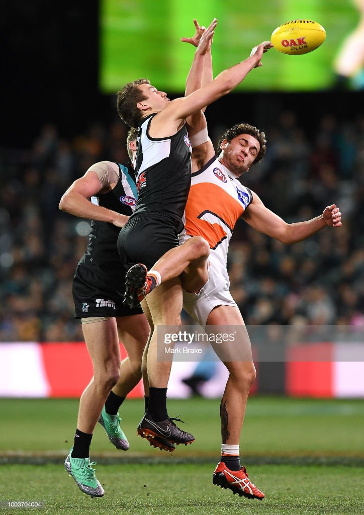 Jack Trengove of Port Adelaide spoils Tim Taranto of the Giants during the round 18 AFL match between the Port Adelaide Power and the Greater Western Sydney Giants at Adelaide Oval on July 22, 2018 in Adelaide, Australia.