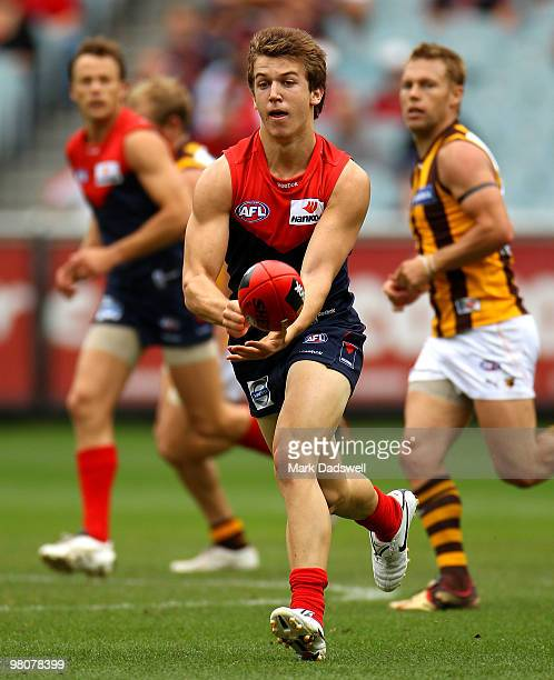 Jack Trengove of the Demons handballs to a teammate during the round one AFL match between the Melbourne Demons and the Hawthorn Hawks at Melbourne...