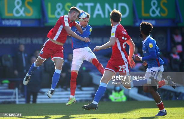 Jack Tucker of Gillingham FC and Ronan Curtis of Portsmouth FC head the ball during the Sky Bet League One match between Portsmouth and Gillingham at...