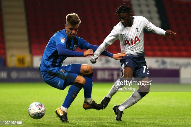 Jack Tucker of Gillingham holds off Rodel Richards of Tottenham Hotspur u21's during the Checkatrade Trophy Group Stage match between Gillingham and...