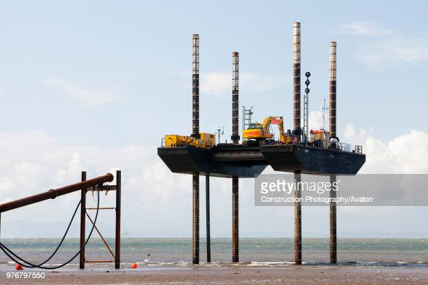 A jack up barge working on the foreshore of the Solway Firth near Workington installing the power cable that will carry the electricity from the new...