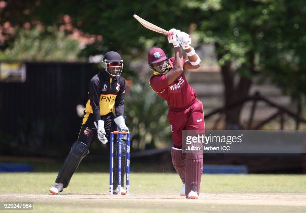 Jack VareKevere of Papua New Guinea looks on as Marlon Samuels of The West Indies hits out during The Cricket World Cup Qualifier between The West...