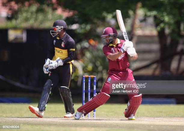 Jack VareKevere of Papua New Guinea looks on as Shai Hope of The West Indies hits out during The Cricket World Cup Qualifier between The West Indies...