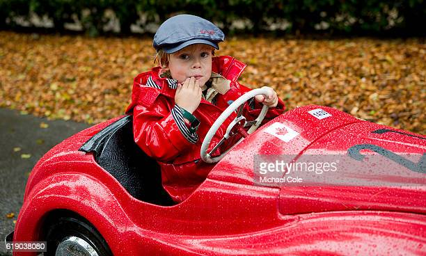 Jack Venables on his way back to the paddock in an Austin J40 pedal car entered by Philip Venables in the wet having competed in the Settrington Cup...