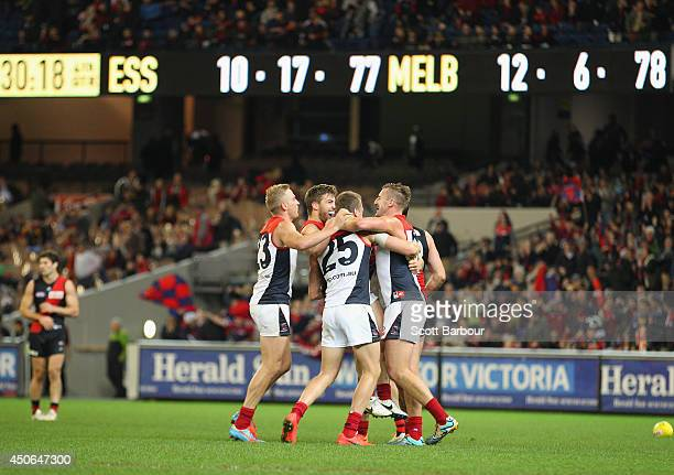 Jack Viney and the Demons celebrates at the final siren after winning the round 13 AFL match between the Essendon Bombers and the Melbourne Demons at...