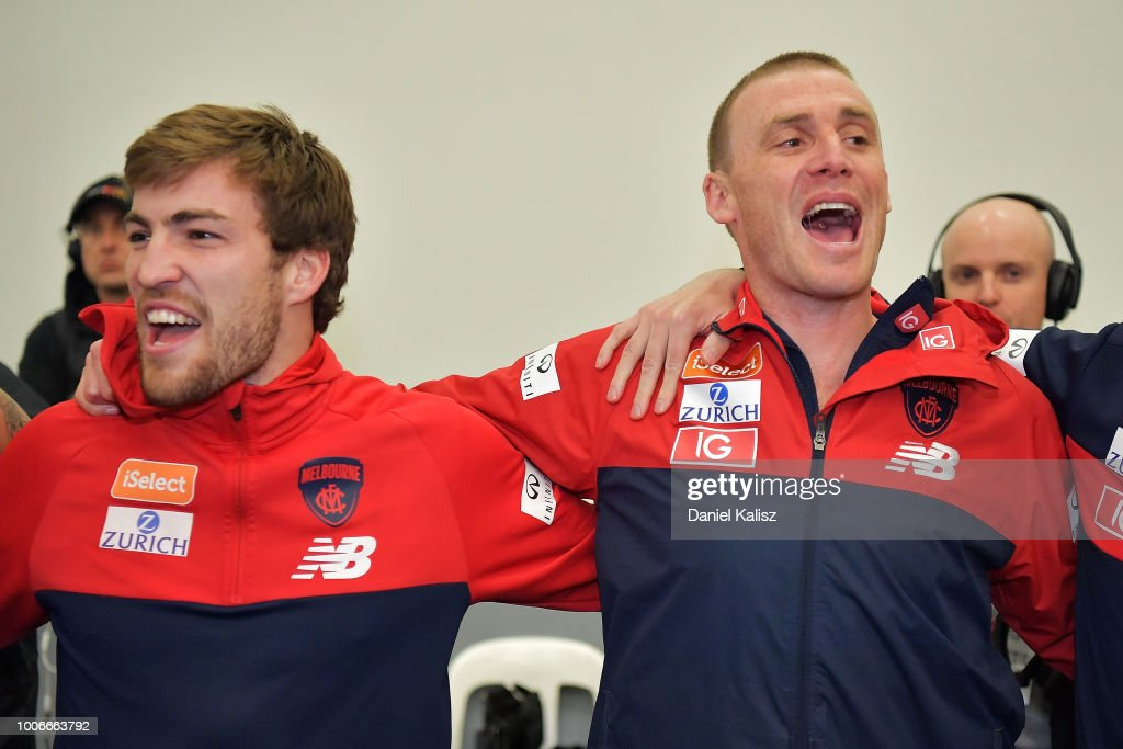 Jack Viney of the Demons and Demons head coach Simon Goodwin sing the club song after the round 19 AFL match between the Adelaide Crows and the Melbourne Demons at Adelaide Oval on July 28, 2018 in Adelaide, Australia.
